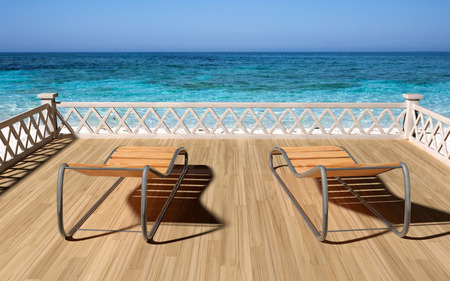 overlooking: Two wooden deck overlooking the beach from a balcony Stock Photo