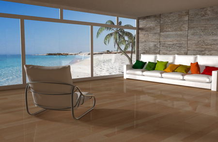 Room with a couch, chair and beach view Stock Photo
