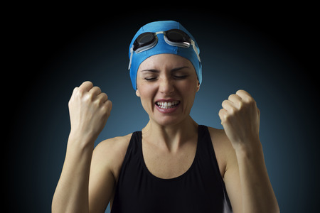 defeat: Swimmer is in despair after the defeat in a competition Stock Photo