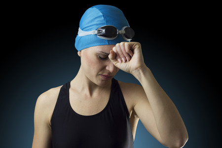 Swimmer is in despair after the defeat in a competition Standard-Bild
