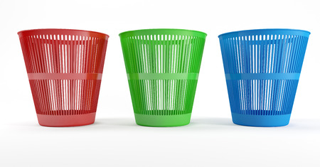 Three colored plastic waste bins with a white background photo