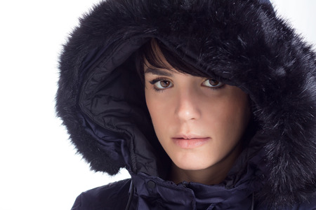Girl with winter coat posing, white background