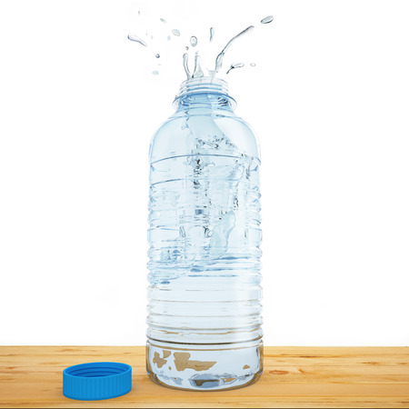 Plastic bottle of water emits splashing above a table