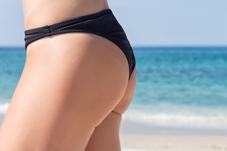 The profile of the backside of a girl at the sea