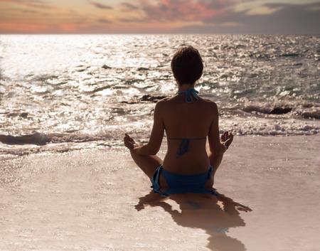A yoga lotus position on a beach