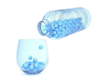 h2o: A plastic water bottle full of sphere with h2o write pours into a glass Stock Photo