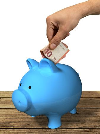 10 euro entered into a piggy bank Reklamní fotografie