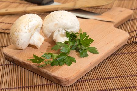 Mushroom on a cutting board with parsley Reklamní fotografie