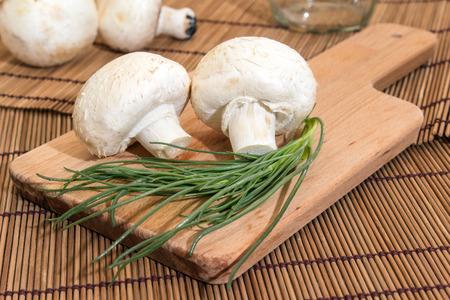 Mushrooms on a cutting board with salsola soda