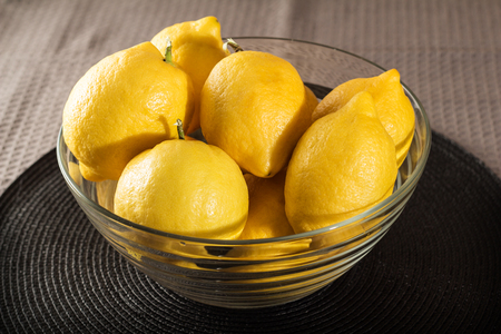 Group of lemons in a glass container
