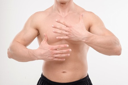 naked man: Close up portrait of strong masculine torso with hands