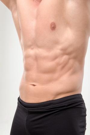 Man athlete doing fitness, abdominal exercises  Isolated on white background  Close up portrait photo