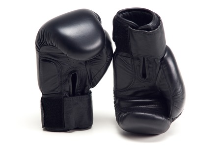 Pair of black boxing gloves isolated on white background