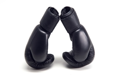 Pair of black boxing gloves isolated on white background photo
