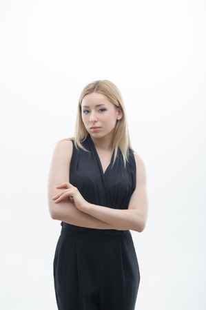 Portrait of serious young business woman with arms folded isolated on white background photo