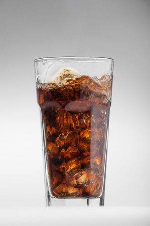 longdrink: Cola glass with ice cubes isolated on a white background Stock Photo