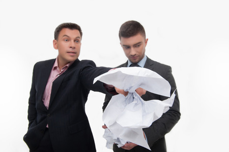 selected: Senior and junior business people  Boss angry with employee looking down, holding crumpled paper selected focus, isolated on white Stock Photo