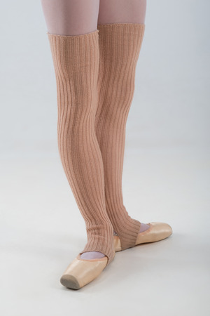 dancer legs: Closeup portrait of a dancer, legs in ballet shoes and long socks dancing in pointe isolated on white background
