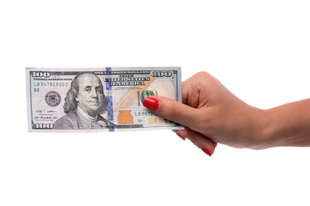 hardships: Woman hand holding 100 dollar bill isolated on white background