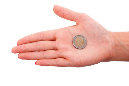 hardships: A coin lying on the woman palm isolated on white background Stock Photo