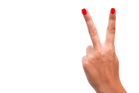 hardships: Woman hand showing us the number two isolated on white background