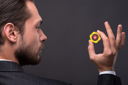 Handsome  confident man   showing ok with  one yellow chip  with copy place