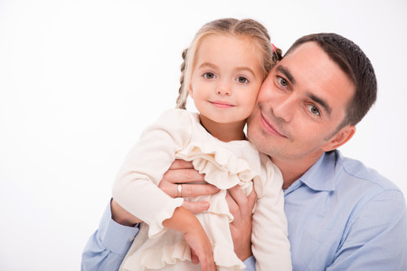 father daughter: Happy family of father embracing  his  daughter  smiling looking  at camera  isolated on white background  waist up with copy place