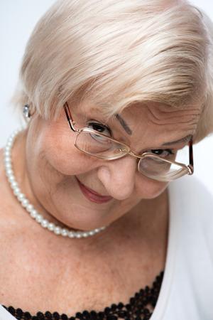 Closeup of lovely elderly woman Stock Photo