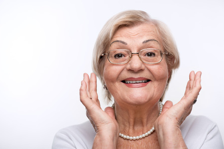 a year older: Elderly lady is happy Stock Photo