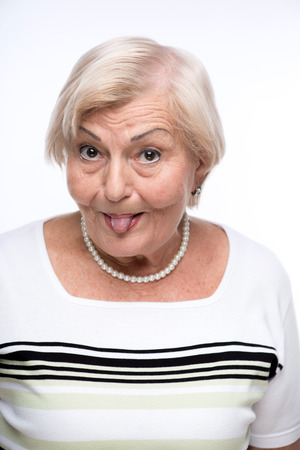 bad manners: Naughty granny making faces