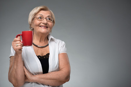 Elderly woman with cup of coffee Stock Photo