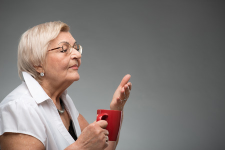 residental care: Elderly woman with cup of coffee Stock Photo