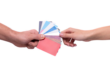 visiting: Hand passing visiting cards to other person Stock Photo