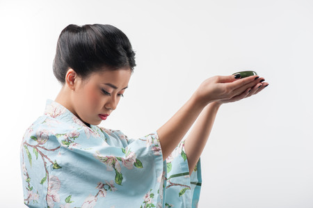 Tea ceremony conducted by Asian woman Stock Photo