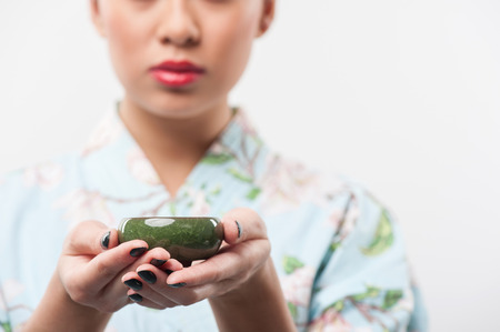 conducted: Tea ceremony conducted by Asian woman Stock Photo