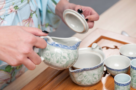 for tea: Asian beauty getting ready for tea ceremony Stock Photo