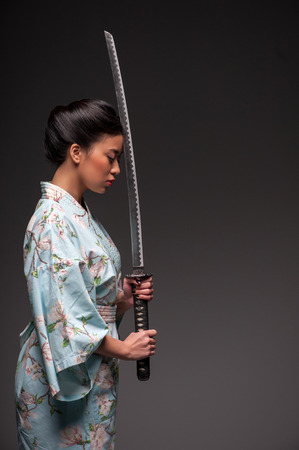 japanese kimono: Japanese woman with katana Stock Photo