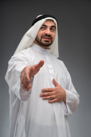 headcloth: Arab business man stretching out his hand
