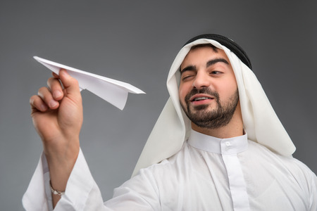 Arab businessman with paper airplane photo