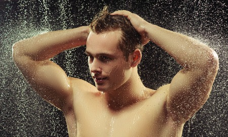 nude sport: Handsome young man taking a shower Stock Photo