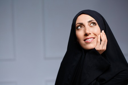 woman looking up: Beautiful muslim woman posing in chador Stock Photo