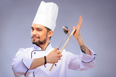 Portrait of young handsome cook Stock Photo