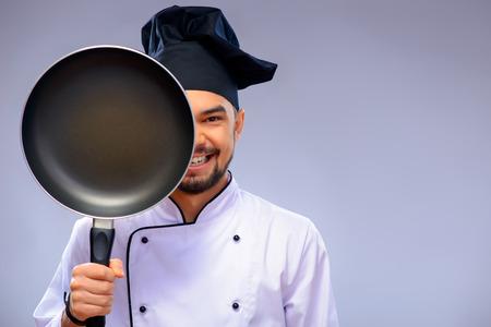 Portrait of young handsome cook 写真素材