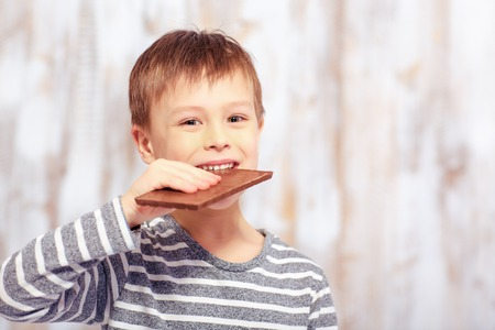 raised eyebrow: Portrait of little boy with a chocolate