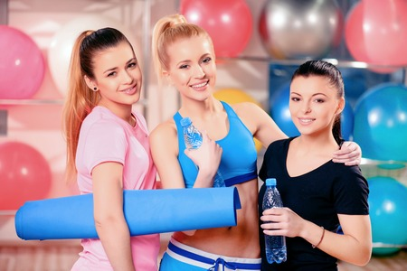 Beautiful women in sports club photo