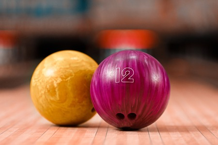 bowling ball: It will be strike. Closeup of two bright bowling balls staying against bowling alley Stock Photo