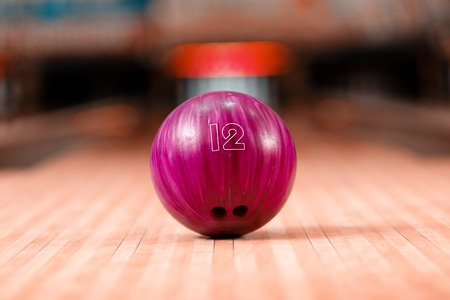 bowling strike: Bowling in details. Closeup of lilac bowling ball lying on bowling alley