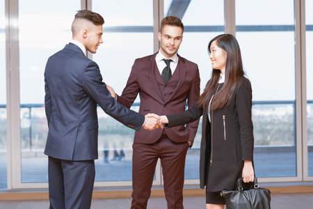 acquaintance: Acquaintance. Handsome businessman introducing the new colleague to his co-worker