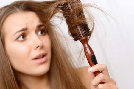 matted: Totally upset.  Girl having problems with her matted hair.