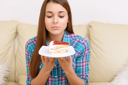 wanting: I want it. Girl wanting nice piece of tasty cake.
